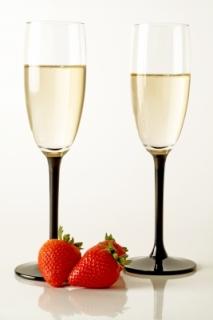 Champagne flutes with strawberries Courtesy of m. bartosch www.freedigitalphotos.net