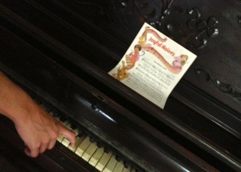 An old piano--not the one I played as a child, but close.